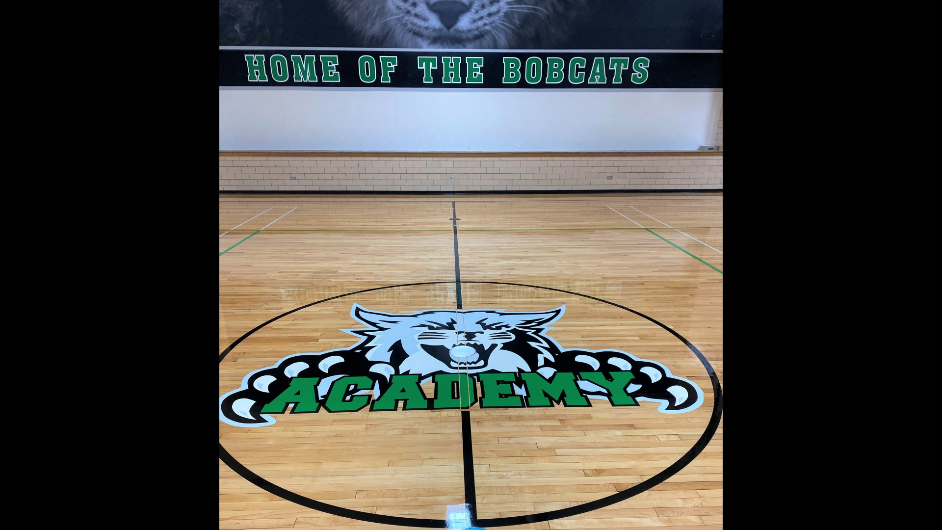 slidshow image - New flooring and logo in the gym -