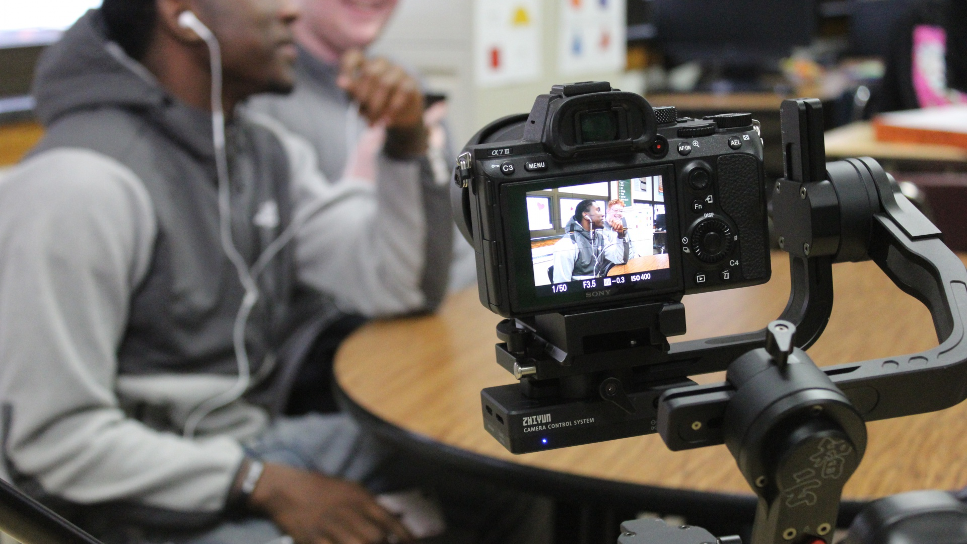 slidshow image - Students record commercial with Joliet Public Library for class project  -